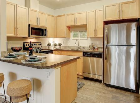 Kitchens at Newberry Square Apartments in Lynwood, WA