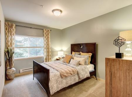 Master bedroom at Newberry Square Apartments in Lynwood, WA