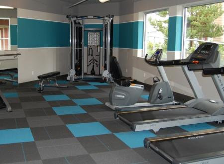 Fitness center at Newberry Square Apartments in Lynwood, WA