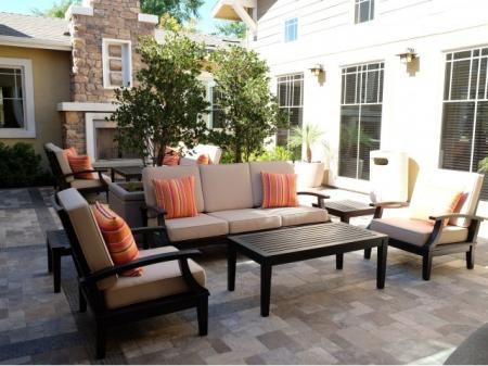 Outdoor fireplace lounge at Dakota Apartments in Winchester CA