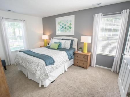 Master bedroom at The Village at Avon Apartments in Avon, OH.