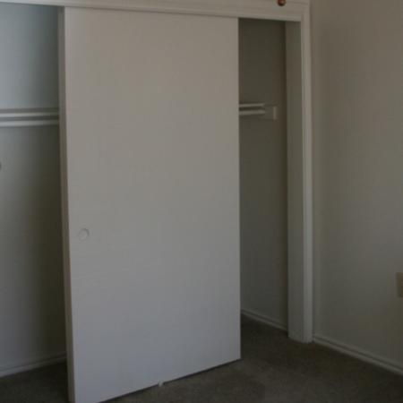 Bedroom closet at Valley Ridge Apartment Homes in Lewisville, TX