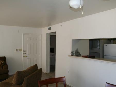 Kitchen open to living room at Valley Ridge Apartment Homes in Lewisville, TX