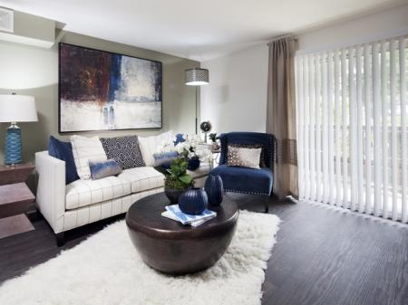 Spacious living areas with enclosed patios at Ardenne Apartments in Lafayette, CO located near Boulder, CO