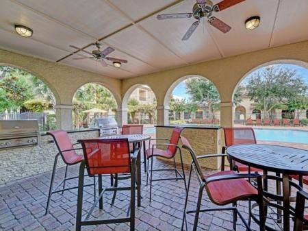Loggia with grill at Brisa at Shadowlake Apartments in Houston, TX
