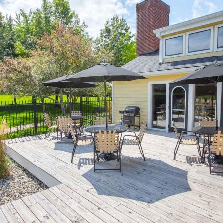 Poolside grilling areas at Summer Ridge Apartments in Kalamazoo, Michigan