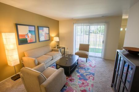 Living room at Oaks at Hampton Apartments in Rochester Hills, Michigan