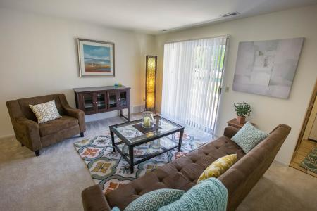 Light filled living spaces at Oaks at Hampton Apartments in Rochester Hills, Michigan