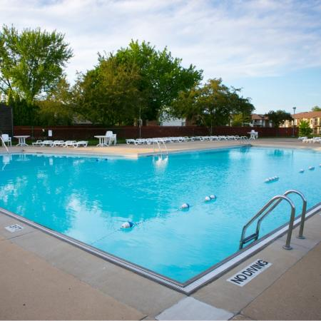 Huge outdoor swimming pool at Oaks at Hampton Apartments in Rochester Hills, Michigan