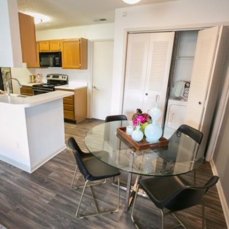 Kitchen with breakfast bar at Williamsburg Townhomes Rental Homes in Sagamore Hills, OH