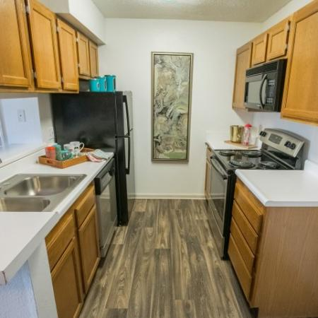Black and stainless steel appliances at Williamsburg Townhomes
