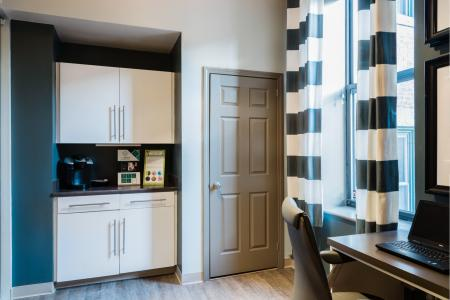 Business center with coffee bar at Baker Chocolate Factory Apartments in Boston, MA
