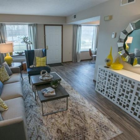 Living room with wood look flooring at Westchester Townhomes Rental Homes in Westlake, OH