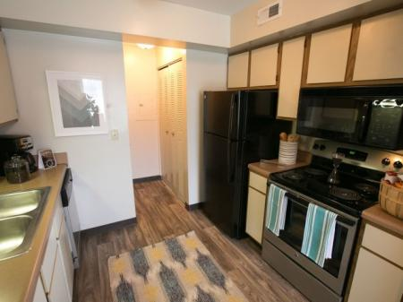 Kitchen with wood look flooring and stainless appliances at Westchester Townhomes Rental Homes in Westlake, OH