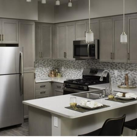 Kitchen at Valentia Apartments in La Habra, CA
