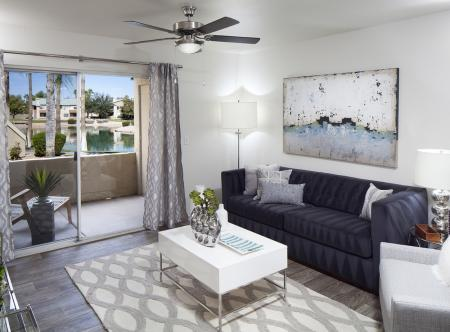 Living room with wood-inspired flooring at Lakeview at Superstition Springs Apartments in Mesa AZ