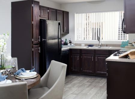 Kitchen with dark cabinets at Lakeview at Superstition Springs Apartments in Mesa AZ