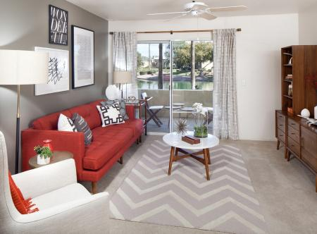 Living room with carpet at Lakeview at Superstition Springs Apartments in Mesa AZ