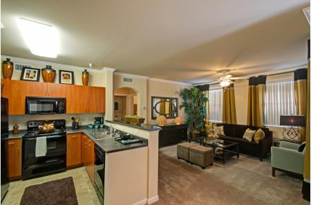 One bedroom kitchen and living room at Ridgestone Apartments in Lake Elsinore CA