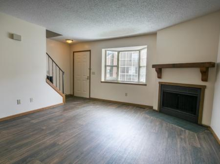 Wood-style flooring and gas fireplace at Bedford Commons in Columbus, Ohio