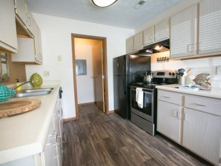 Kitchen with hardwood-style flooring at Heathermoor Apartments in Columbus, OH