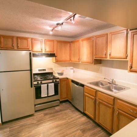 Upgraded kitchens with silver appliances and wood-style flooring available at Mallard's Crossing in Medina, Ohio