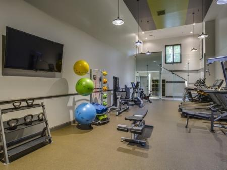 Free weights at Adler at Waters Landing Apartments in Germantown, MD