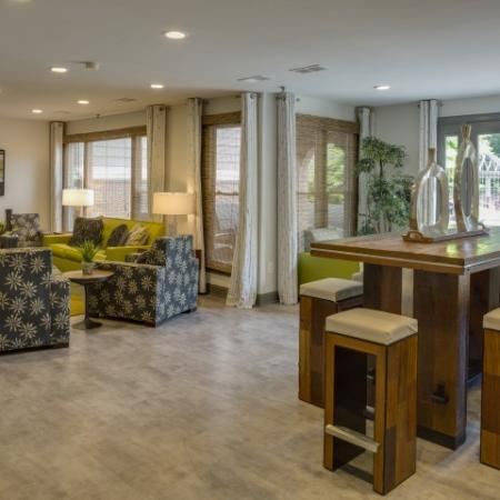 Dining area in resident lounge at Adler at Waters Landing Apartments in Germantown, MD