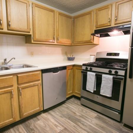 Updated kitchen with faux wood floors at Mallard's Crossing in Medina, OH