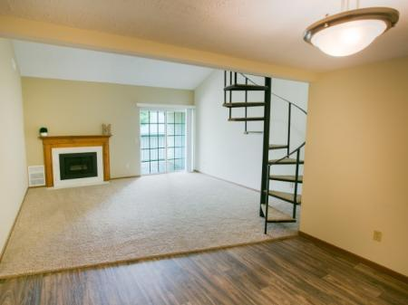 New faux wood flooring and a spiral staircase at Mallard's Crossing in Medina, OH