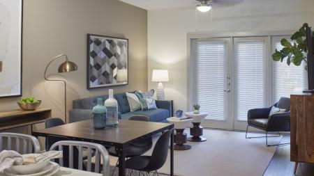 Open living spaces with wood-style flooring at Mave Apartments in Stoneham, MA