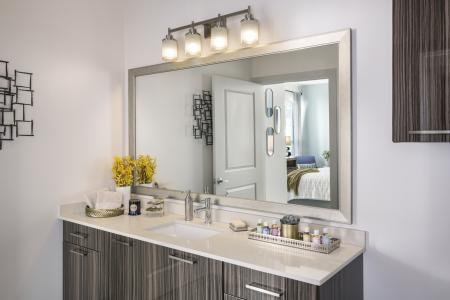 Framed mirror and quartz countertops at Talia Luxury Apartments in Marlborough, MA