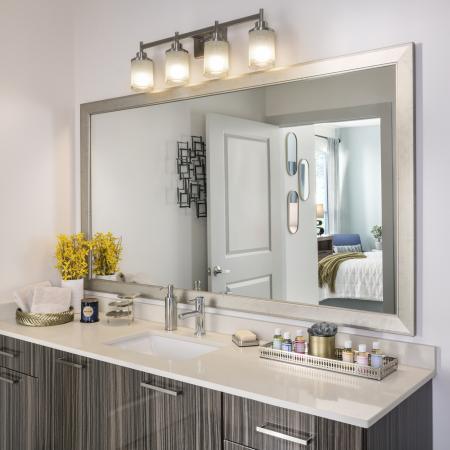 Framed mirror and quartz countertops at Talia Luxury Apartments in Marlborough, MA