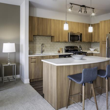 Harmony color scheme with natural color cabinets and quartz countertops at Talia Luxury Apartments in Marlborough, MA
