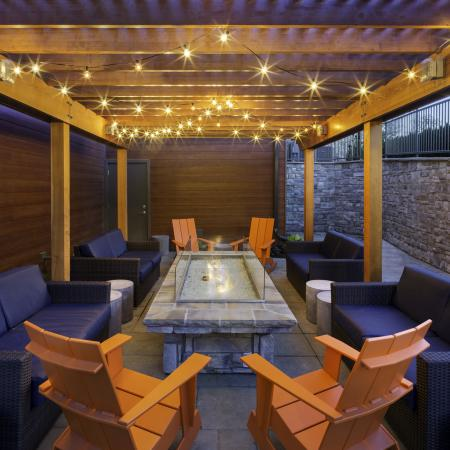 Relax at the outdoor lounge with firepit at Talia Luxury Apartments in Marlborough, MA