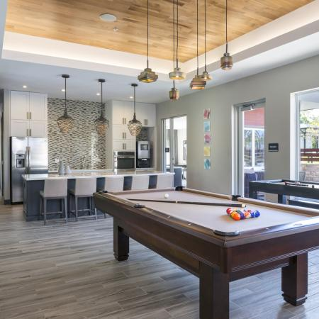 Meet and greet in the social lounge fully equipped with billiards, shuffle board, and a demonstration kitchen at Talia Luxury Apartments in Marlborough, MA