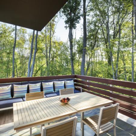 Take in the view in our tree house veranda at Talia Luxury Apartments in Marlborough, MA