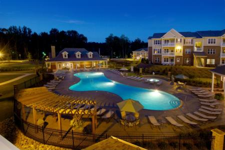 Pool at night at Colton Creek Apartments in McDonough, GA