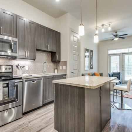 Smoky kitchen design package at Inwood Station apartments in Dallas TX