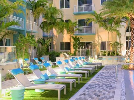 Pool seating at ORA Flagler Village Apartments in Fort Lauderdale FL