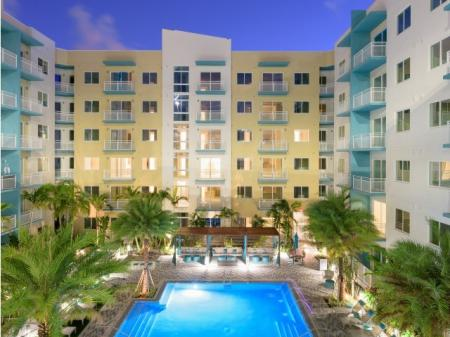 Night view of the pool at ORA Flagler Village Apartments in Fort Lauderdale FL