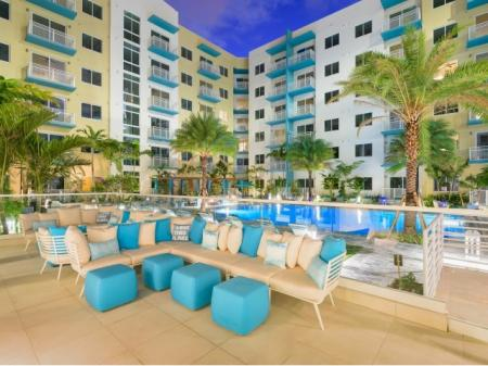 Exterior social spaces pool side at ORA Flagler Village Apartments in Fort Lauderdale FL