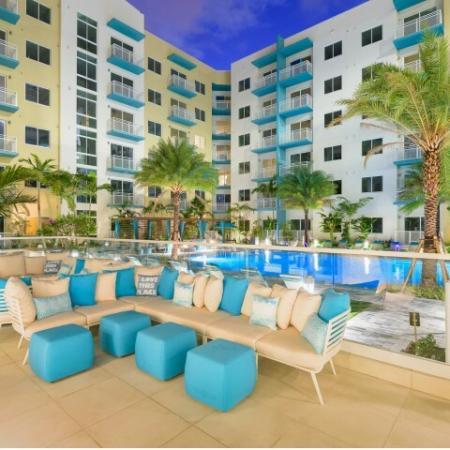 Exterior social spaces pool side at ORA Flagler Village Apartments in Fort Lauderdale FL