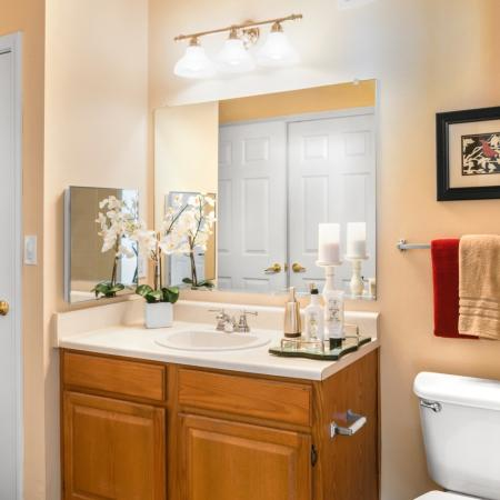 Spacious bathroom with ample storage at River Pointe at Den Rock Park Apartments in Lawrence, MA
