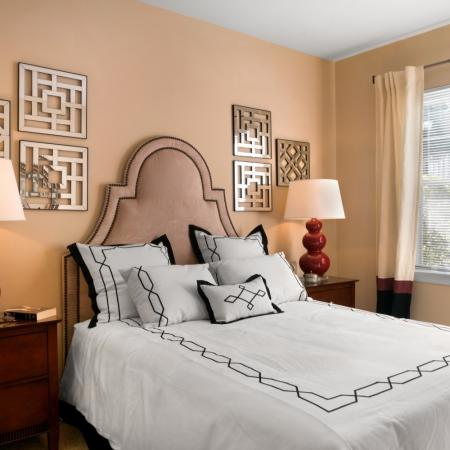 Light filled bedroom at River Pointe at Den Rock Park Apartments in Lawrence, MA