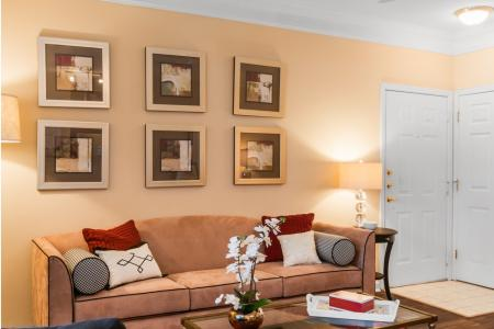 Living room with 9' ceilings and beautiful crown molding at River Pointe at Den Rock Park Apartments