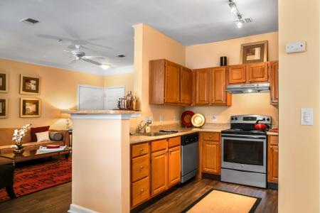 Kitchen with silver appliances at River Pointe at Den Rock Park Apartments