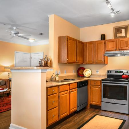 Kitchen with silver appliances at River Pointe at Den Rock Park Apartments in Lawrence, MA