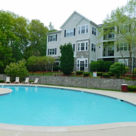 Swimming pool with large sundeck at River Pointe at Den Rock Park Apartments in Lawrence, MA
