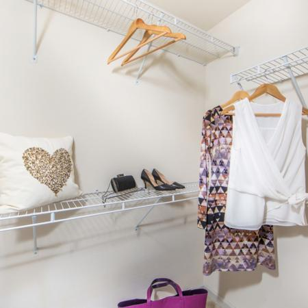 Walk-in closets at River Pointe at Den Rock Park Apartments